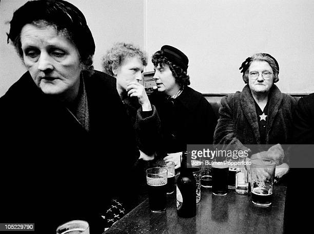 Women drinking beer and stout in a pub in the Black Country, West Midlands, January 1961.