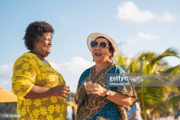women drinking beer at the beach - chubby granny stock pictures, royalty-free photos & images