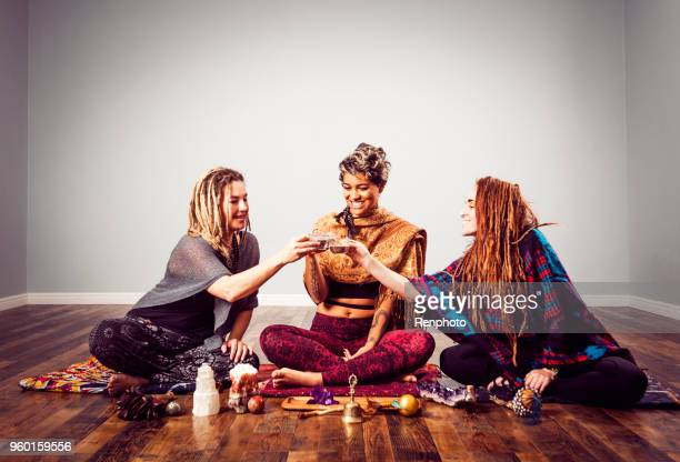 women drinking cacao drink raw chocolate super food - ceremony stock pictures, royalty-free photos & images