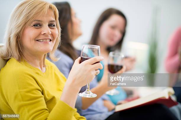 Women Drinking Wine and Reading Books