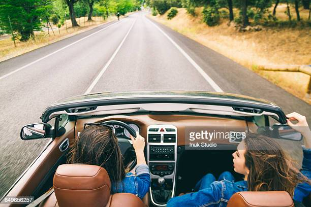 women driving in convertible - family inside car stock photos and pictures