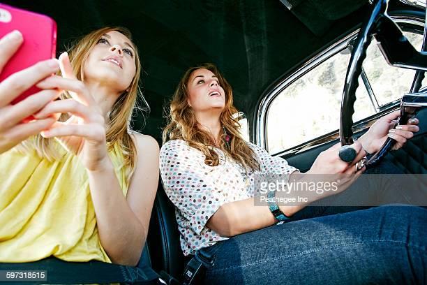 Women driving vintage car