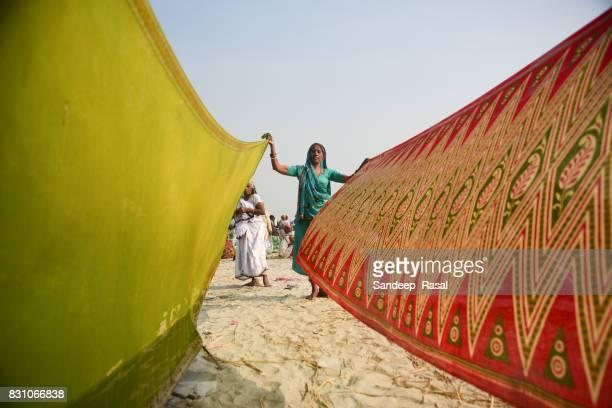 a women drying cloths during ganga sagar fair - ganga sagar stock photos and pictures