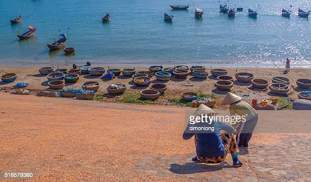 Women drying fishes , Mui Ne , Vietnam