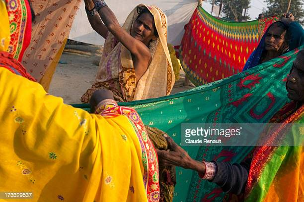Women drying up Saris after having taken their holy bath in Prayag at the Khumbh Mela.