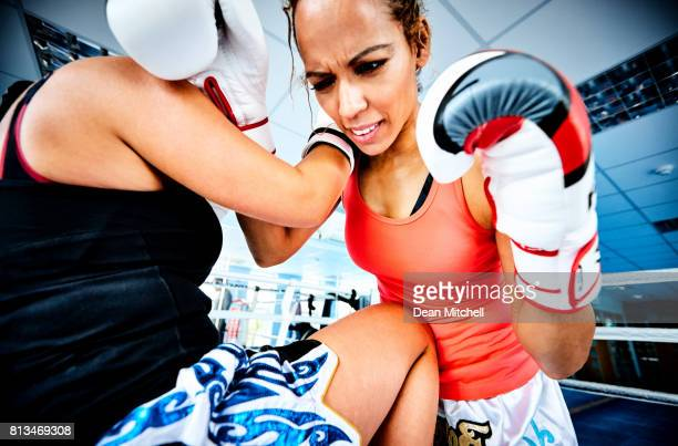 women during kickboxing fight in gym - head injury stock photos and pictures