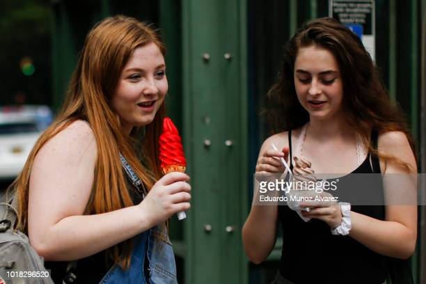 Women eat ice cream during a warm day at Central Park on August 17 2018 in New York City Severe thunderstorms and even an isolated tornado could...