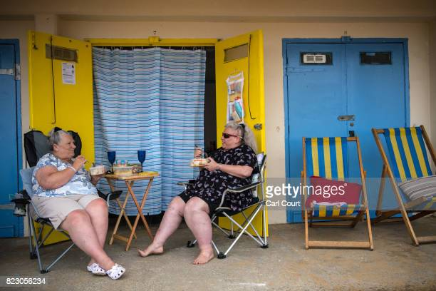 Women eat lunch next to a beach hut on July 26 2017 in Broadstairs England Broadstairs is known as the 'jewel in Thanet's crown' and is a popular...