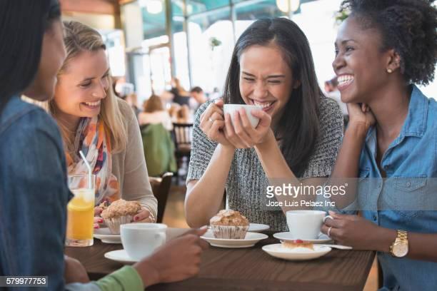 Women eating breakfast in cafe