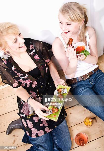 Eating Chicken Wings Stock Photos And Pictures