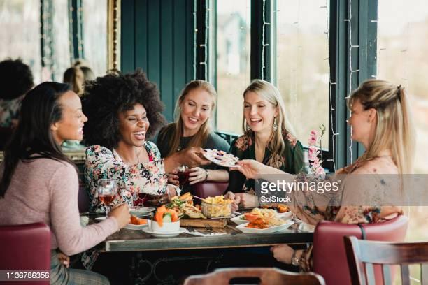 women eating food - north shields stockfoto's en -beelden