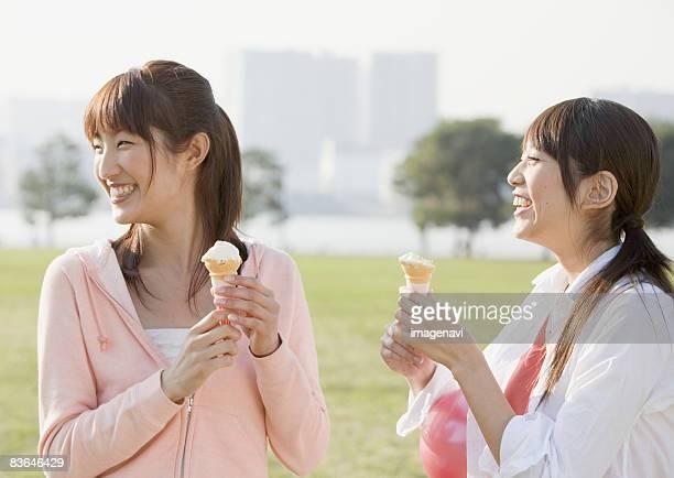 Women eating ice cream cone