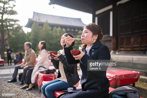Women eating red bean soup in temple, Kyoto