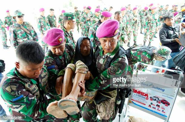 Women elder people and children on board to evacuate by a military aircraft following the earthquake on October 4 2018 in Palu Central Sulawesi...