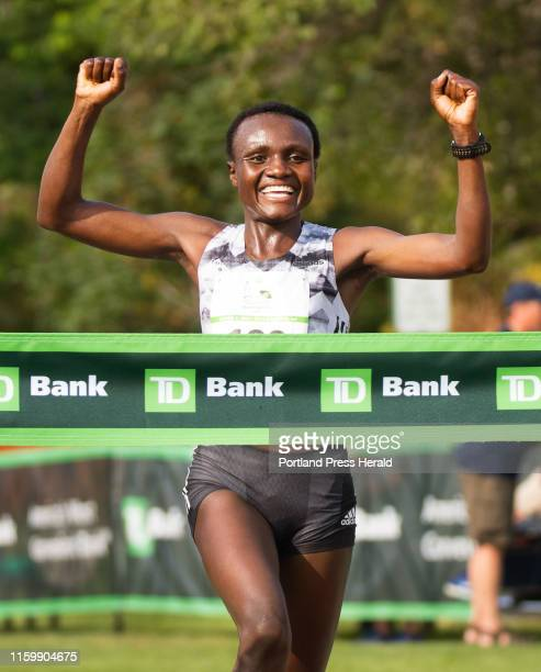 Women Elite winner Joyciline Jepkosgei jubilantly crosses the finish line during the 22nd annual Beach to Beacon 10K race on Saturday August 3 2019