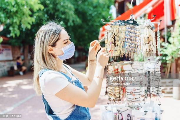 women enjoy shopping for jewelry at city street - pop up store stock pictures, royalty-free photos & images