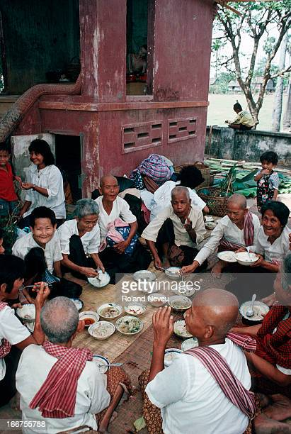 Women enjoy their meal during a dedication ceremony at a small pagoda in Angkor Thom the ancient capital of the 12th century