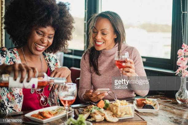 women enjoying a meal together - showus stock pictures, royalty-free photos & images