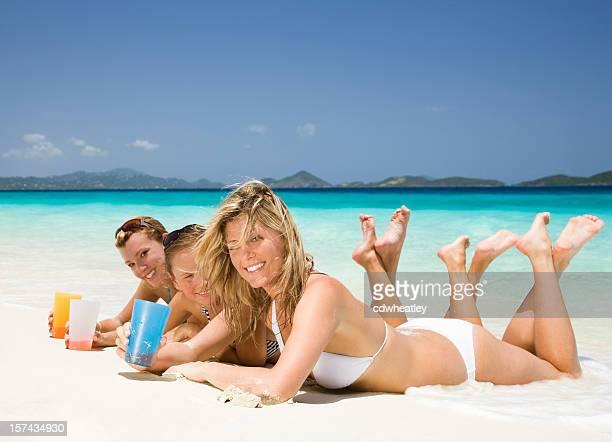 women enjoying cocktails at the beach