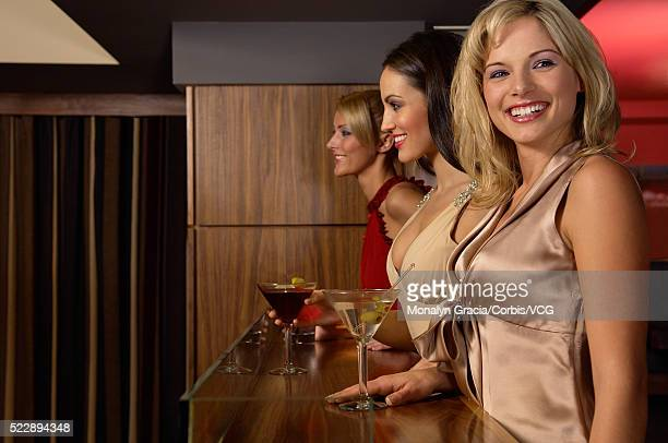 women enjoying drinks at club - cocktail dress stock pictures, royalty-free photos & images