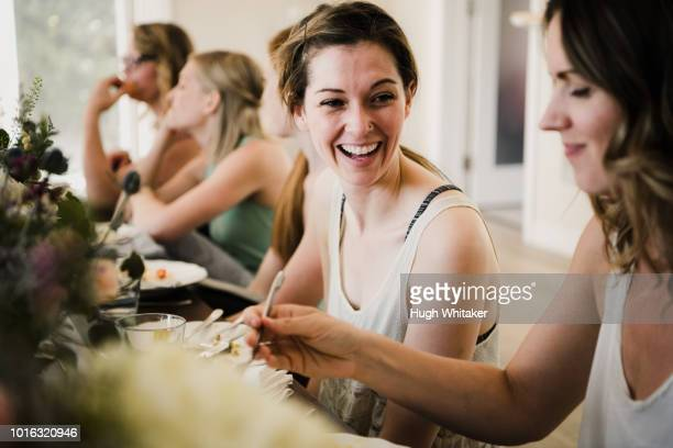 women enjoying friendship and meal in yoga retreat - yogi stock photos and pictures