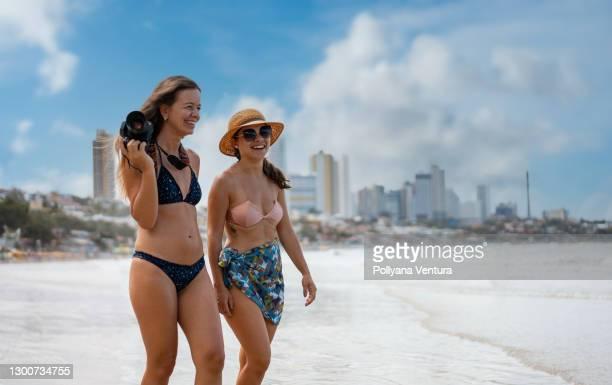 women enjoying holidays on ponta negra beach - natal brazil stock pictures, royalty-free photos & images