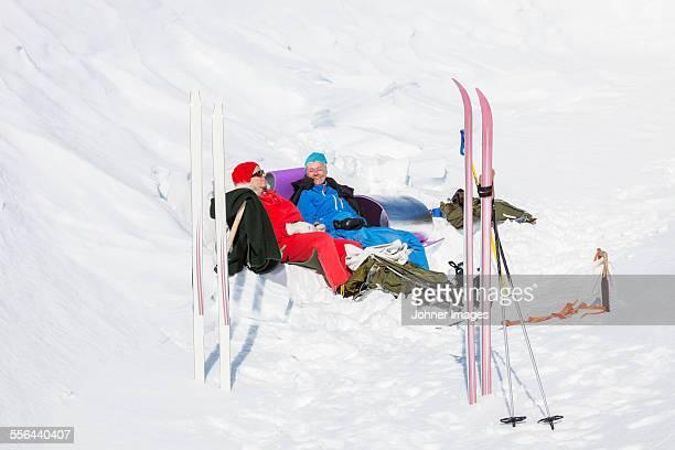 Women enjoying sun at winter