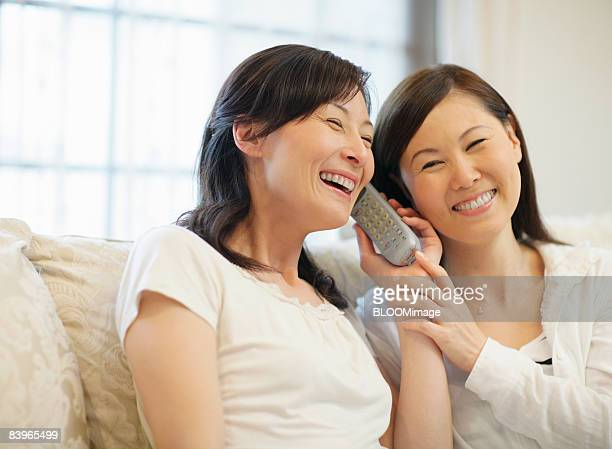 Women enjoying talking on the phone, smiling