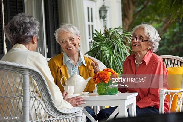Women enjoying tea on porch