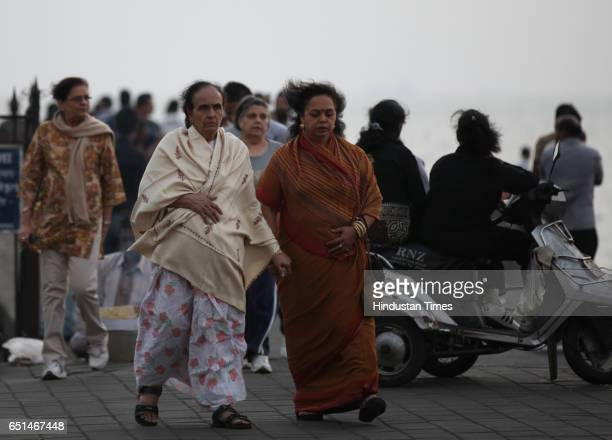 Women enjoying the chilled weather in the evening at Marine Drive on Monday