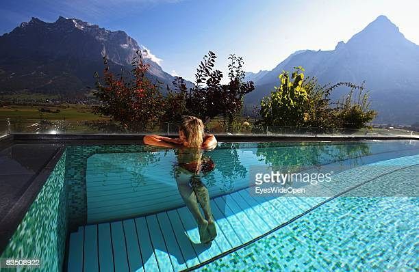 Women enjoying Wellness in hotel Mohr Life Resort in Lermoos with a view on german highest Mountain Zugspitze on October 25 2008 in Lermoos Austria