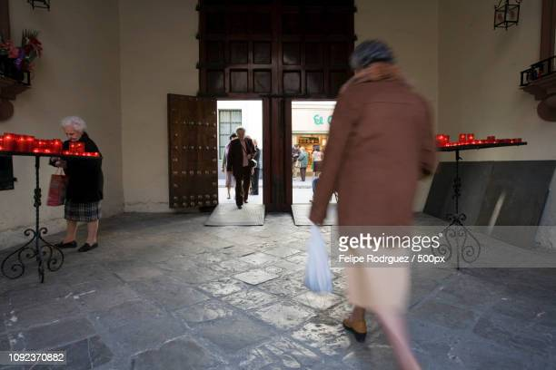 women entering and leaving san antonio abad church, seville, spain - human powered vehicle fotografías e imágenes de stock