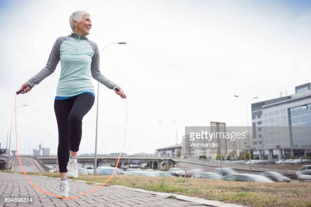 women exercise in city - skipping rope stock pictures, royalty-free photos & images