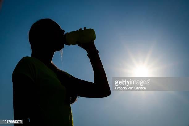 women exercises at home - energydrink stock-fotos und bilder