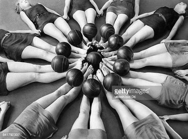 Women exercising gymnastics with balls legs Photographer Keystone Published by 'Berliner Morgenpost' Vintage property of ullstein bild