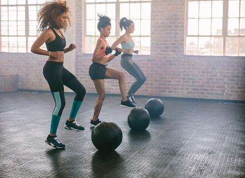 Women exercising in aerobics class 637070810