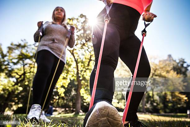 Women exercising in Central Park New York using stretching band