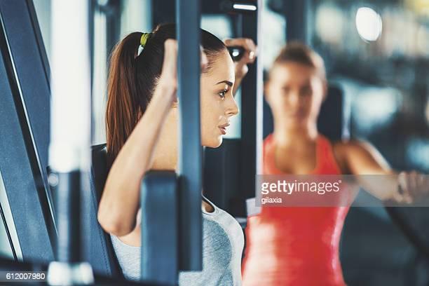 Women exercising in gym.