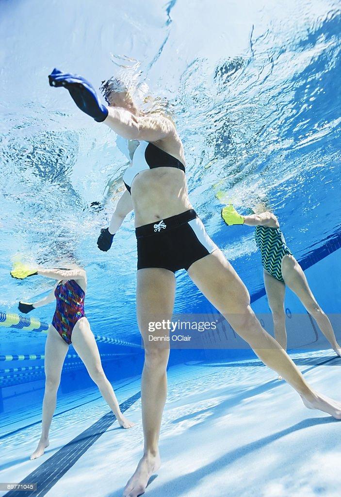 Women exercising in swimming pool. : Stock Photo