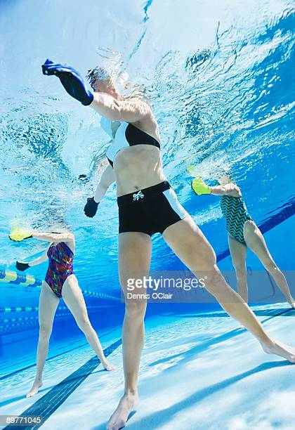 Women exercising in swimming pool.