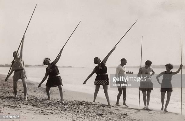 Women exercising in the javelin. Ca. 1930.