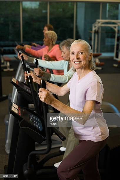 Women Exercising on an Elliptical Trainer