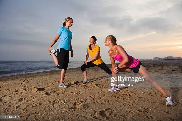 Women exercising on beach