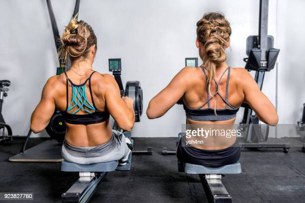 Women exercising on rowing machine