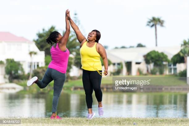women exercising outdoors - chubby black women stock photos and pictures