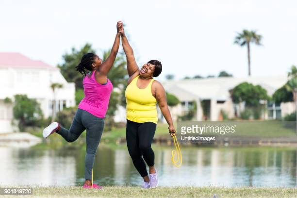 women exercising outdoors - happi stock photos and pictures