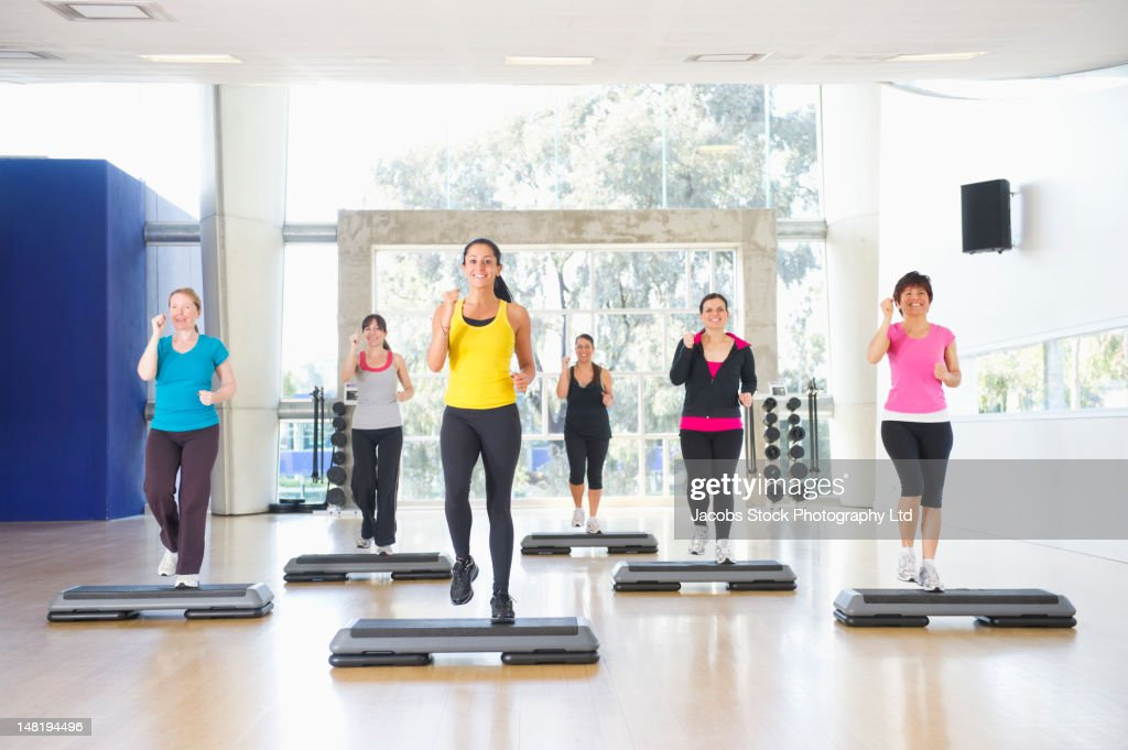Women exercising together in class : Stock Photo
