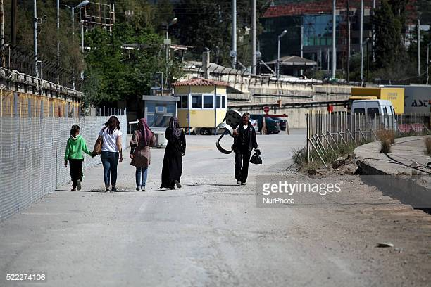 Women exiting the camp Refugee camp in Skaramaga area a port town 11 km west of Athens A large camp is being constructed here with a big capacity and...