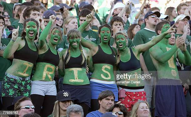 Women fans of the Notre Dame Fighting Irish dress in green paint cheer during the game against the University of Southern California Trojans at Notre...