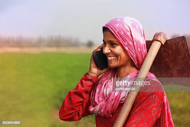Women farmer talking on smart phone